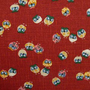 Tissu rouge motis de hiboux