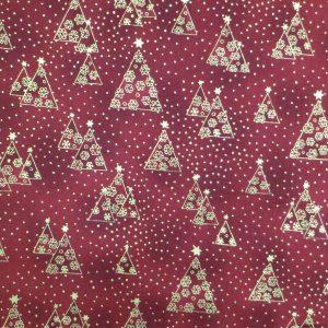 Tissu rouge motifs de sapins de Noël dorés