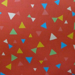 Tissu en velours côtelé rouge capucine à motifs de triangles