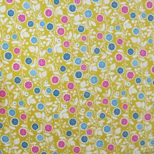 Tissu à petites fleurs colorées sur fond jaune