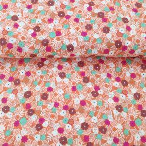 Tissu orange motifs de fleurs et feuilles